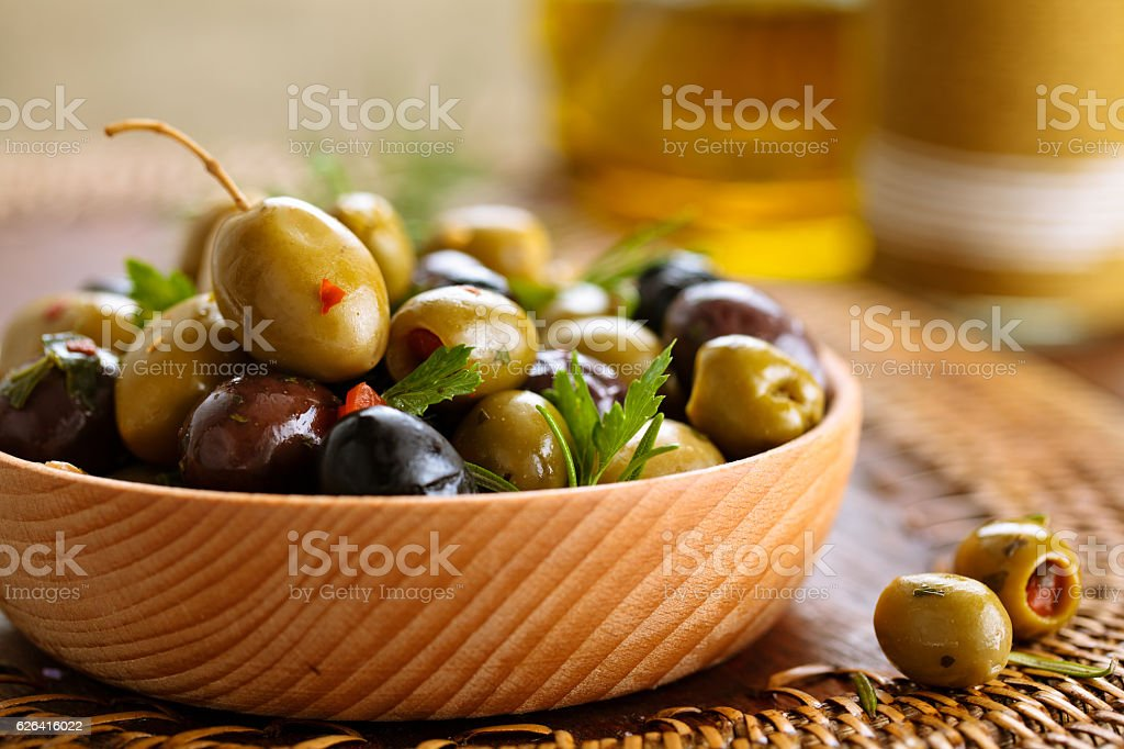 Marinated olives with herbs. stock photo