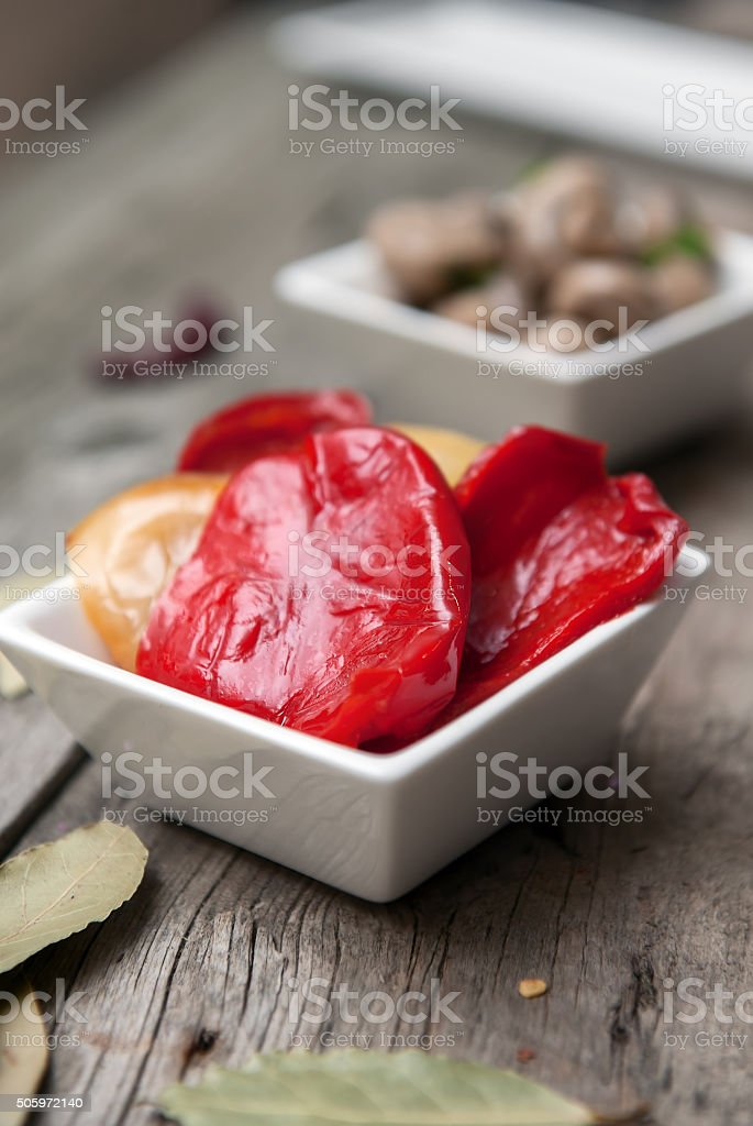 Marinated pepper salad with garlic and herbs stock photo