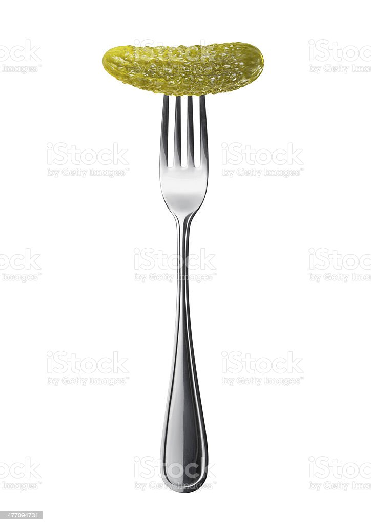 marinated pickled cucumber on a fork royalty-free stock photo