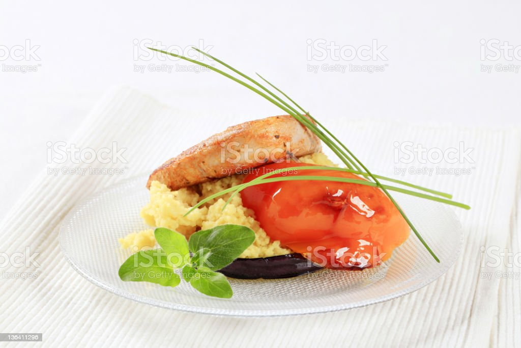 Marinated pork served with couscous royalty-free stock photo