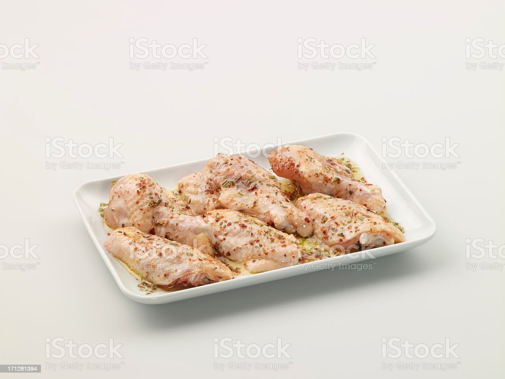 Marinated Raw Chicken Wings In A Plate stock photo