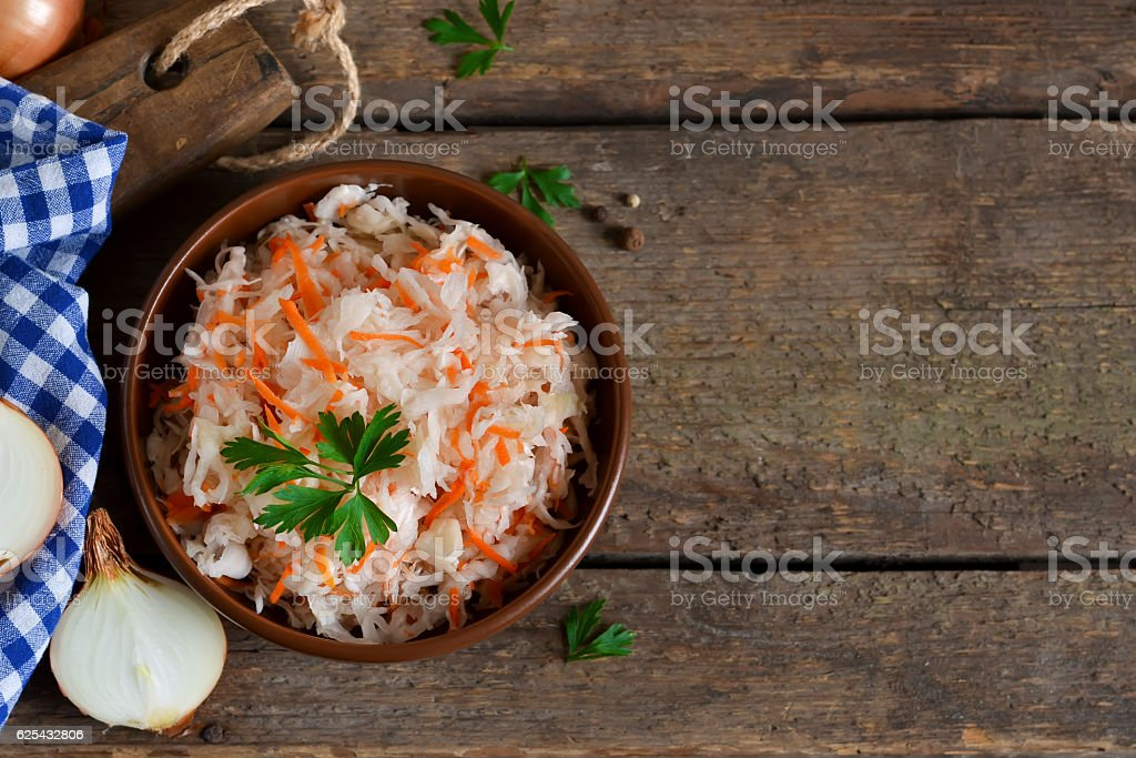 Marinated, sour cabbage with carrots and onions stock photo