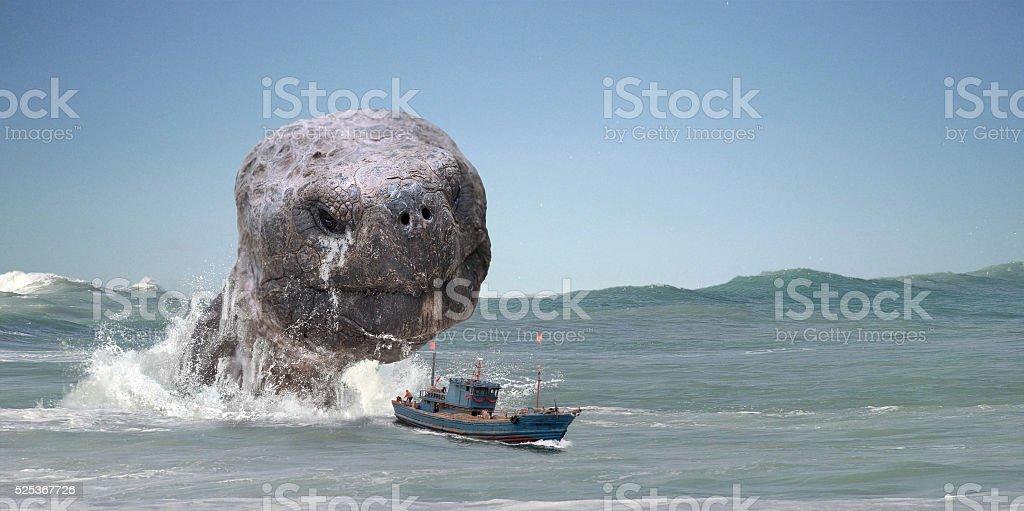 Marine animal attacks fishermen ship. stock photo