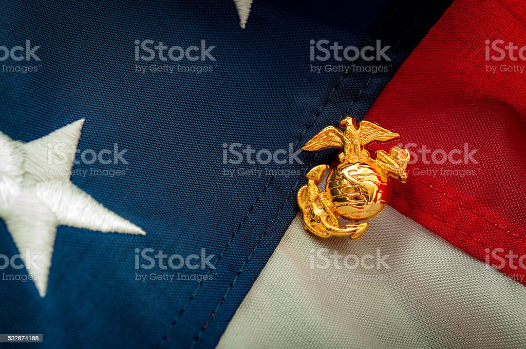 US Marine Corps emblem on the American flag stock photo