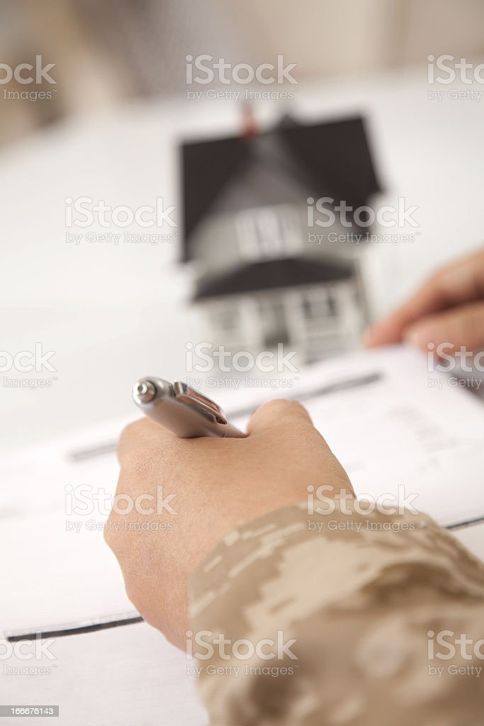 US Marine Female Soldier Holding a  Small House royalty-free stock photo