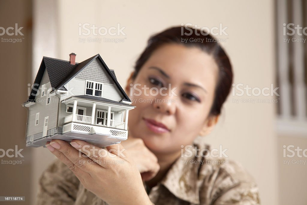US Marine Female Soldier Holding a  Small House stock photo