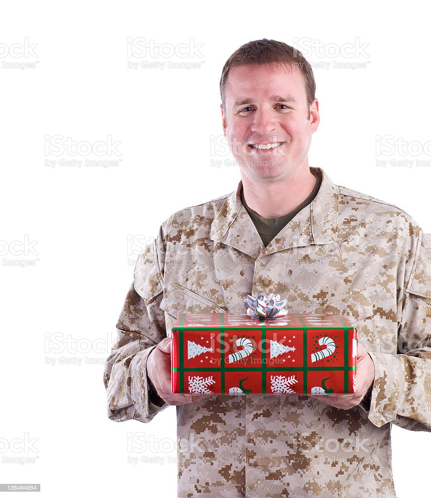 Marine Holds a Christmas Gift stock photo