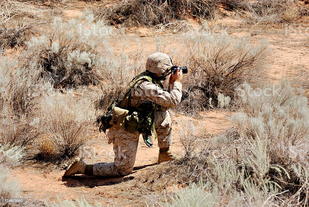Marine In Desert Camo Uniform During Reconnaissance Mission royalty-free stock photo
