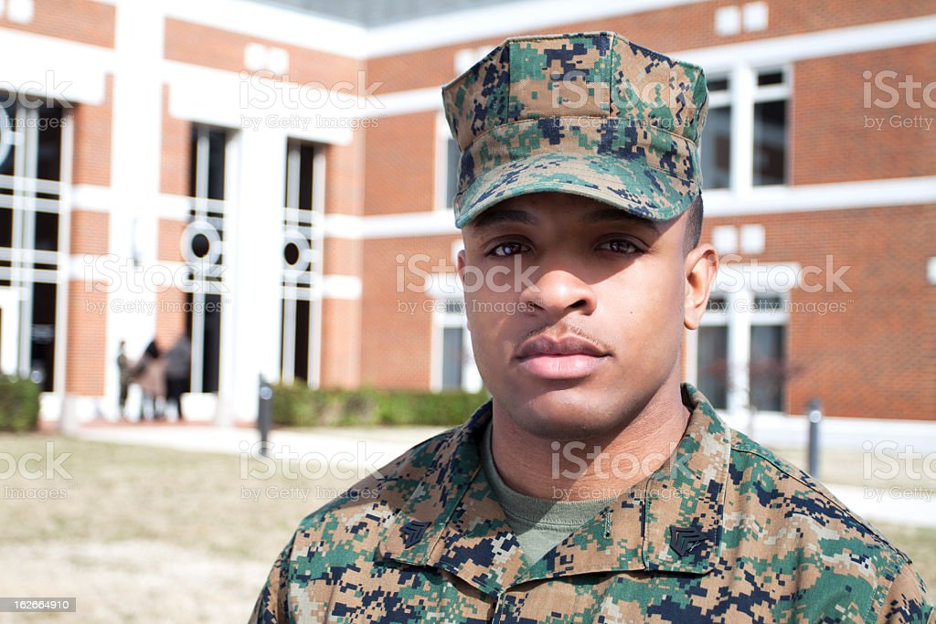 Marine in Front of a Building royalty-free stock photo
