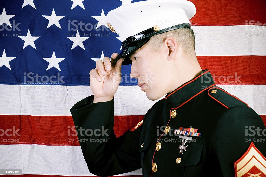 Marine in front of a US flag stock photo