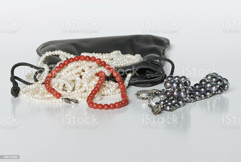 Marine jewelry in leather bag royalty-free stock photo