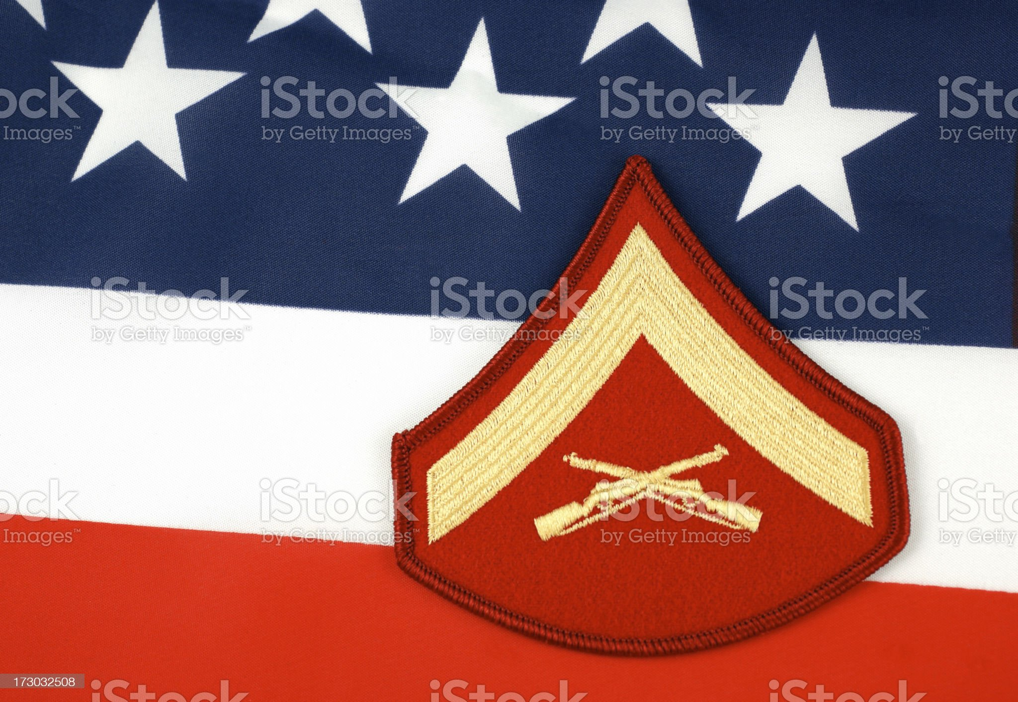 Marine Lance Corporal Rank Insignia with Flag Background royalty-free stock photo