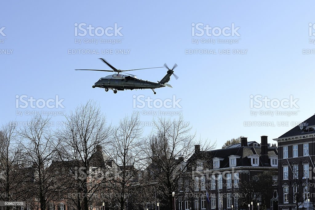 Marine One flying over buildings along the Amsterdam Museumplein stock photo