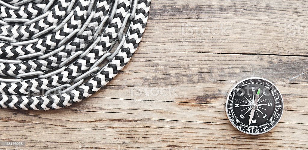 marine roll ropes and chain on wooden background stock photo