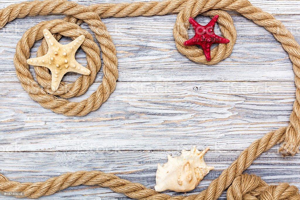 Marine rope and starfish on white boards stock photo