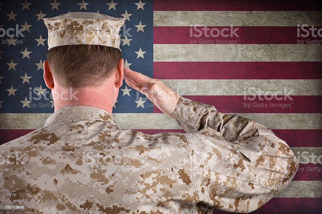 Marine Salutes an American Flag stock photo