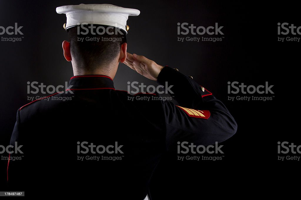 Marine saluting in dress blues stock photo