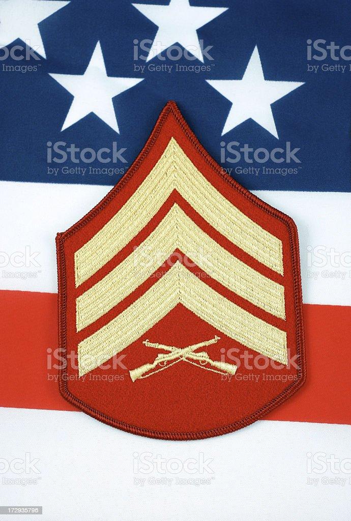 Marine Sergeant Rank Insignia with Flag Background royalty-free stock photo