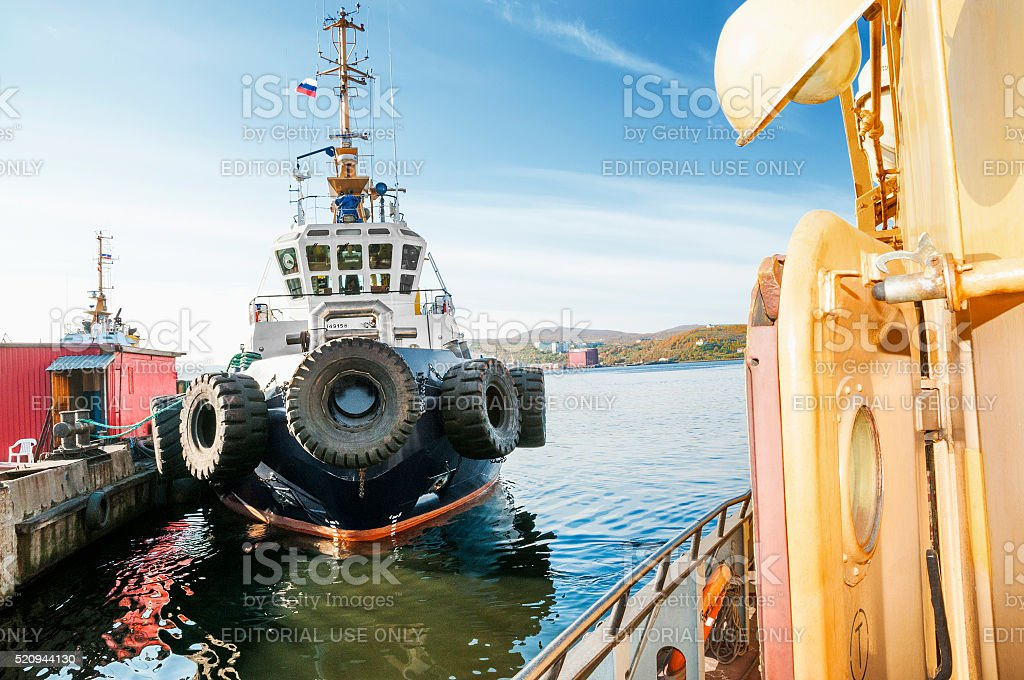 Marine tugs in the port of Murmansk. stock photo