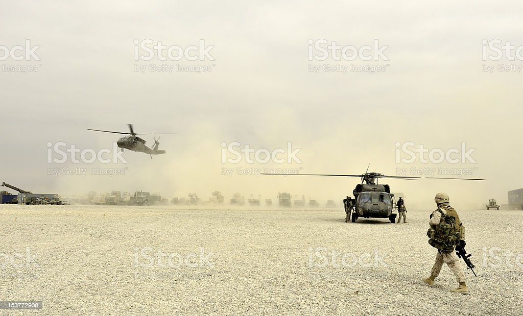 Marine Walking to Helicopters stock photo