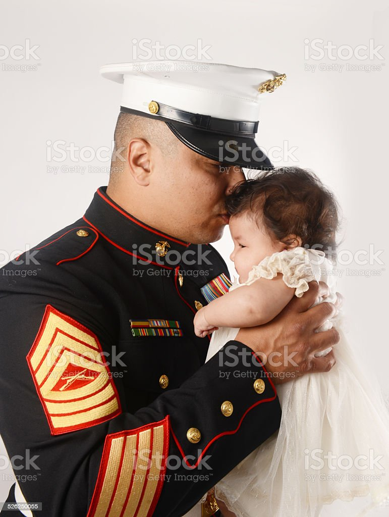 Marine with daughter stock photo