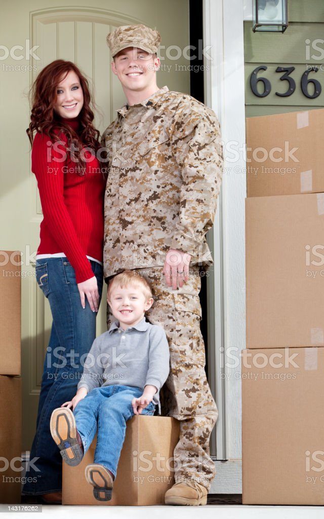 U S Marines & Family Moving into New Home royalty-free stock photo