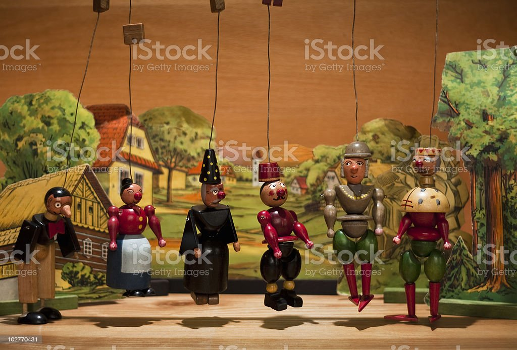 Marionette dolls in a village scene royalty-free stock photo