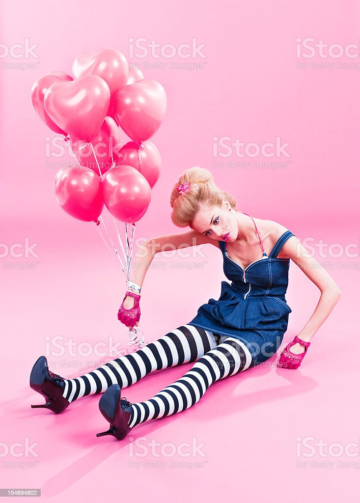 Marionette-like woman with pink balloons royalty-free stock photo