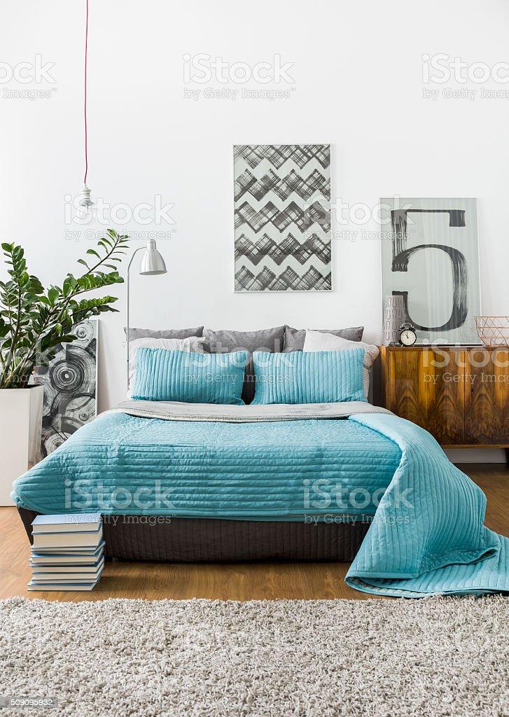 Marital bed in cozy bedroom stock photo