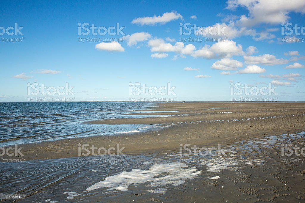 Maritime landscape with reflection of clouds in low tide water stock photo
