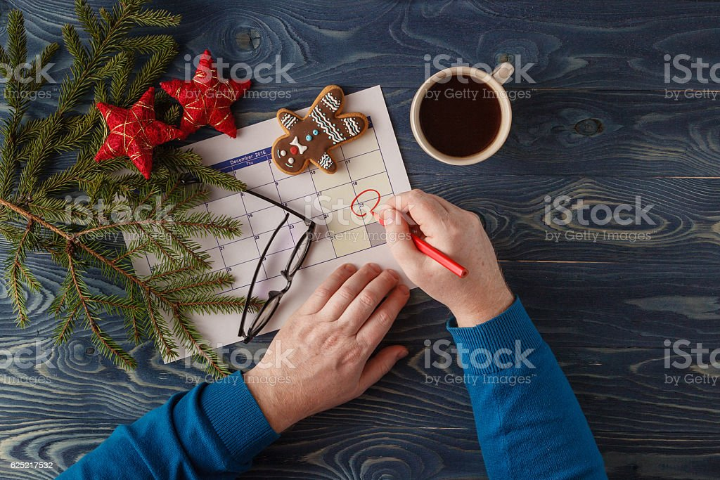 Mark the Date calendar for Christmas, December 25, with festive stock photo