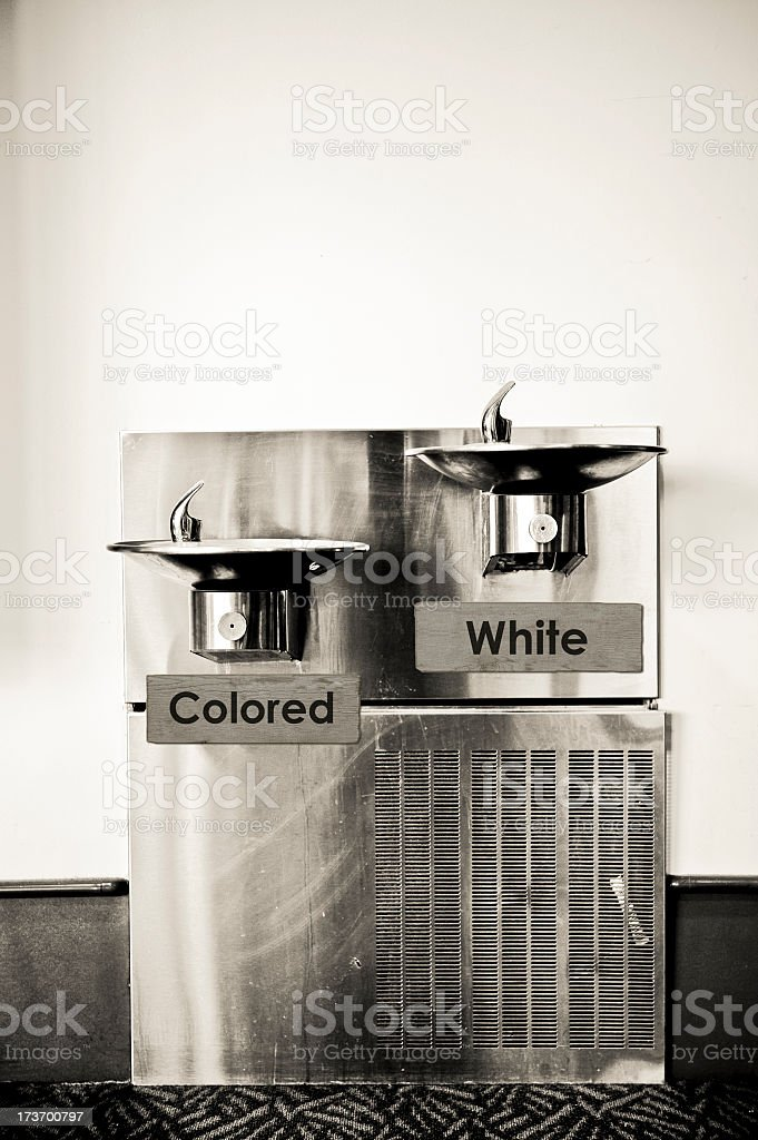 Marked drinking fountains depicting separation and racism stock photo