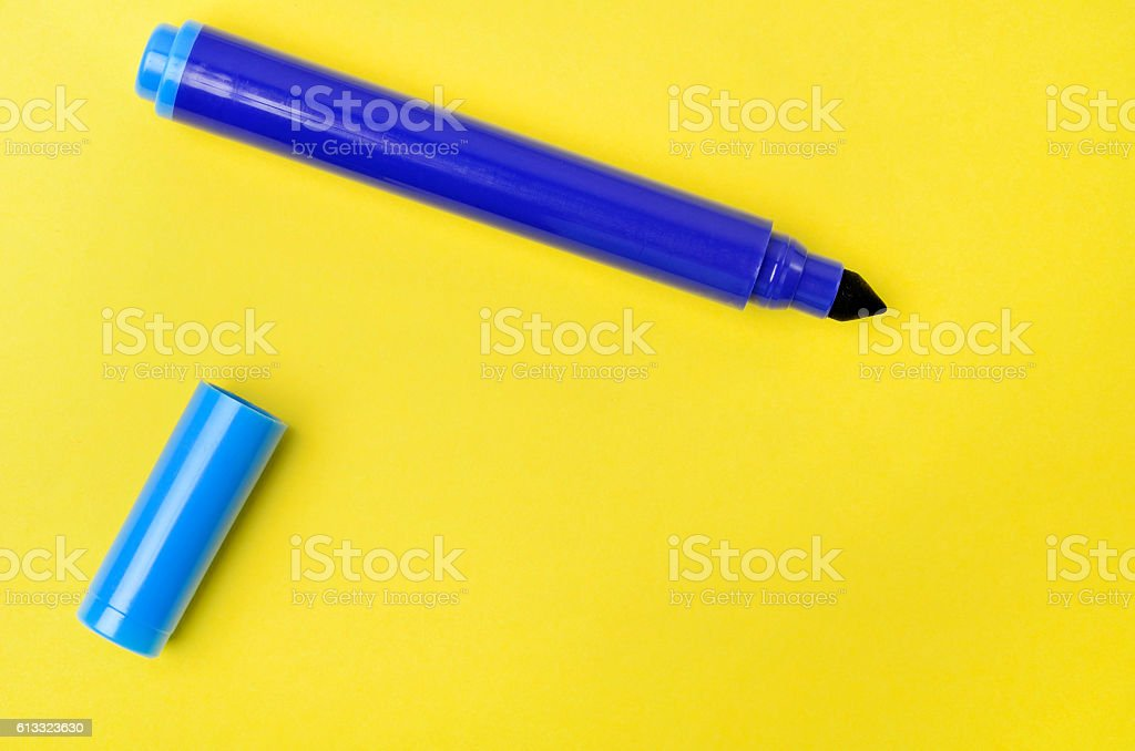 Marker on yellow background stock photo