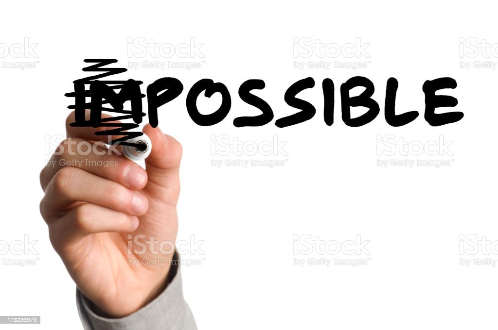 Marker scratching out the I and M in the word impossible stock photo