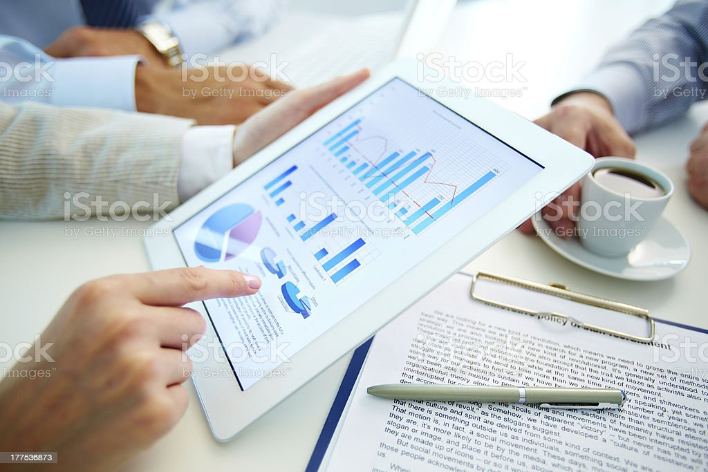Market analysis charts and graphs being observed  royalty-free stock photo