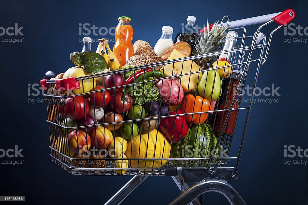 Market cart with groceries royalty-free stock photo