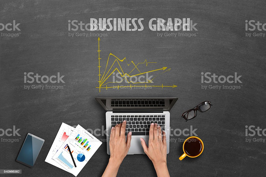 Market research business reports on laptop stock photo