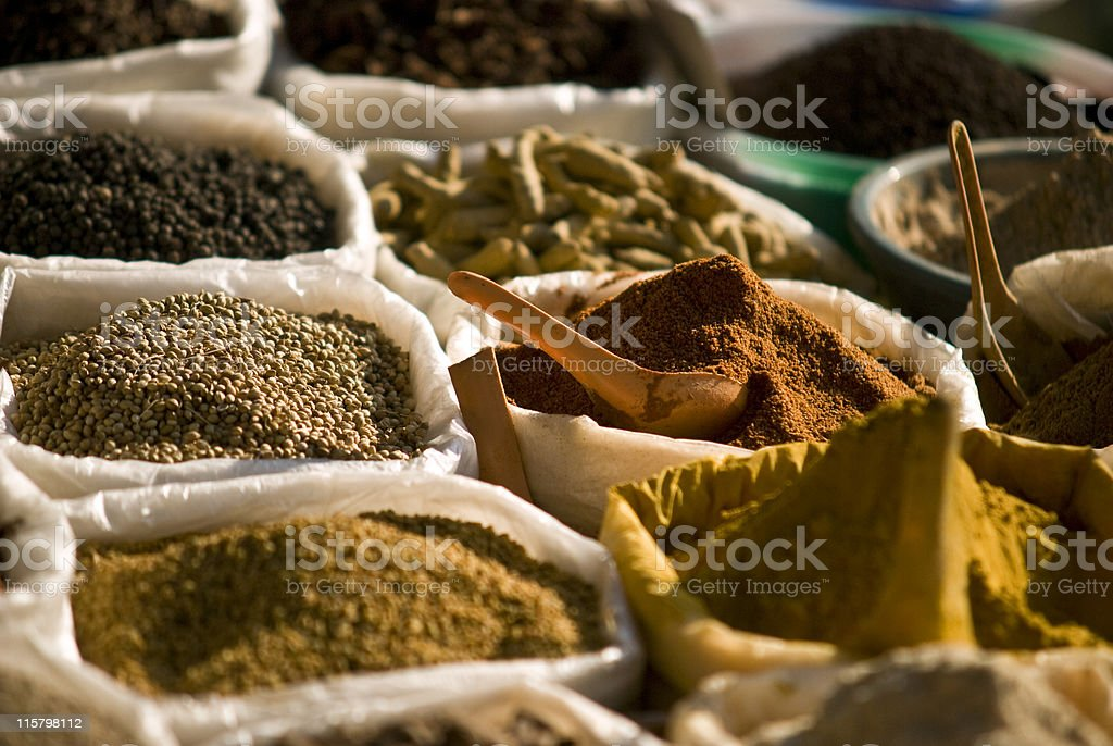 A market sale showing the variety of spices stock photo