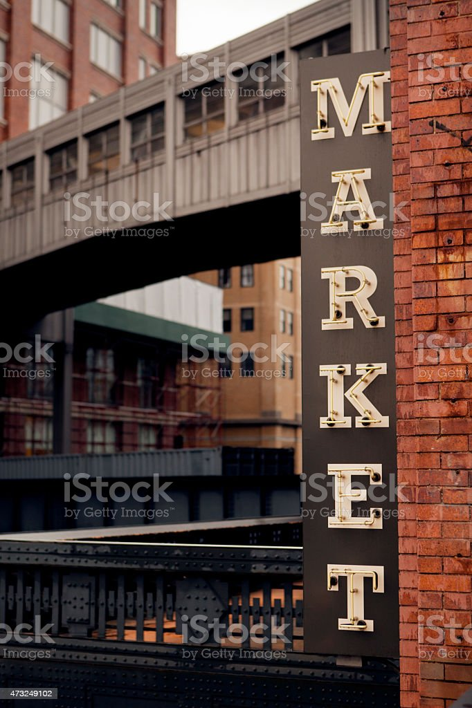 A market sign on a brick building stock photo