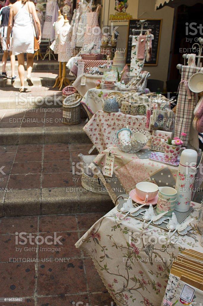 Market stall selling fabrics and bric a brac stock photo