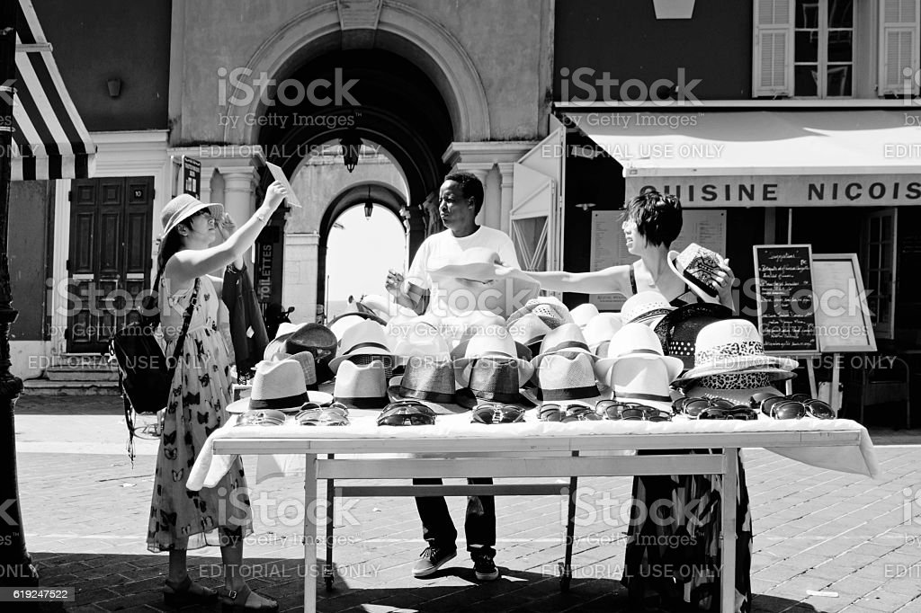 Market stall selling hats stock photo
