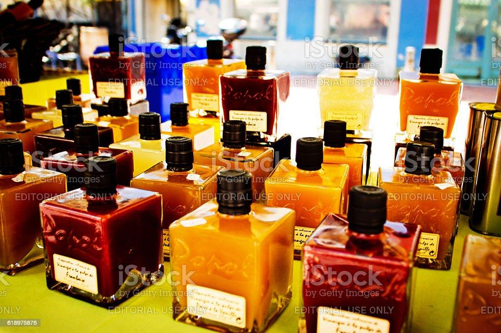 Market stall selling vinaigrette dressings stock photo