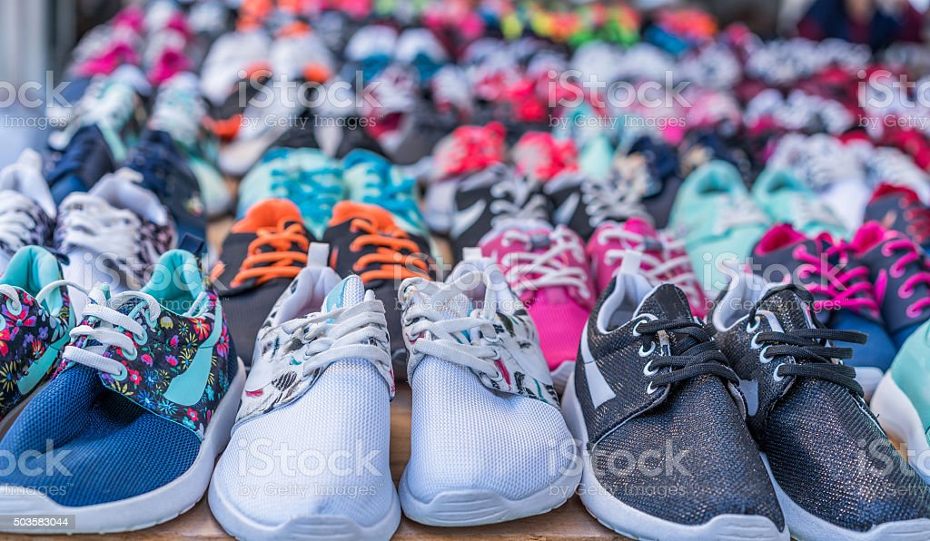 Market stall with colorful indigenous shoes stock photo