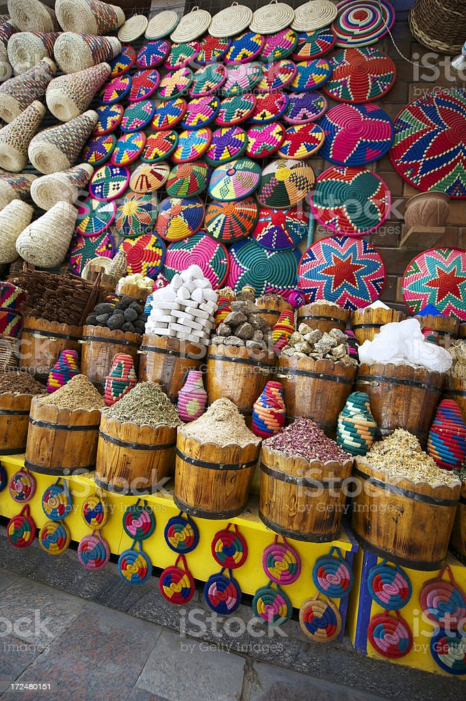 Market Stall with Colorful Souvenirs and Spices royalty-free stock photo