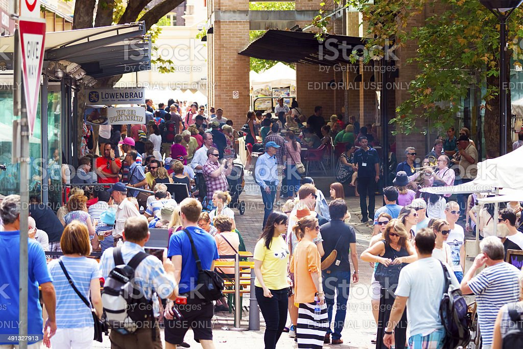 Market stalls and restaurants with big crouwd of people stock photo
