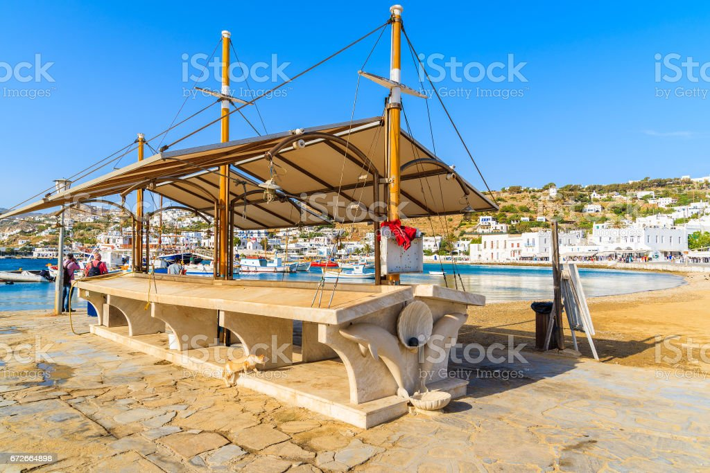 Market stand which is used to present and sell fresh fish in Mykonos port, Cyclades, Greece stock photo