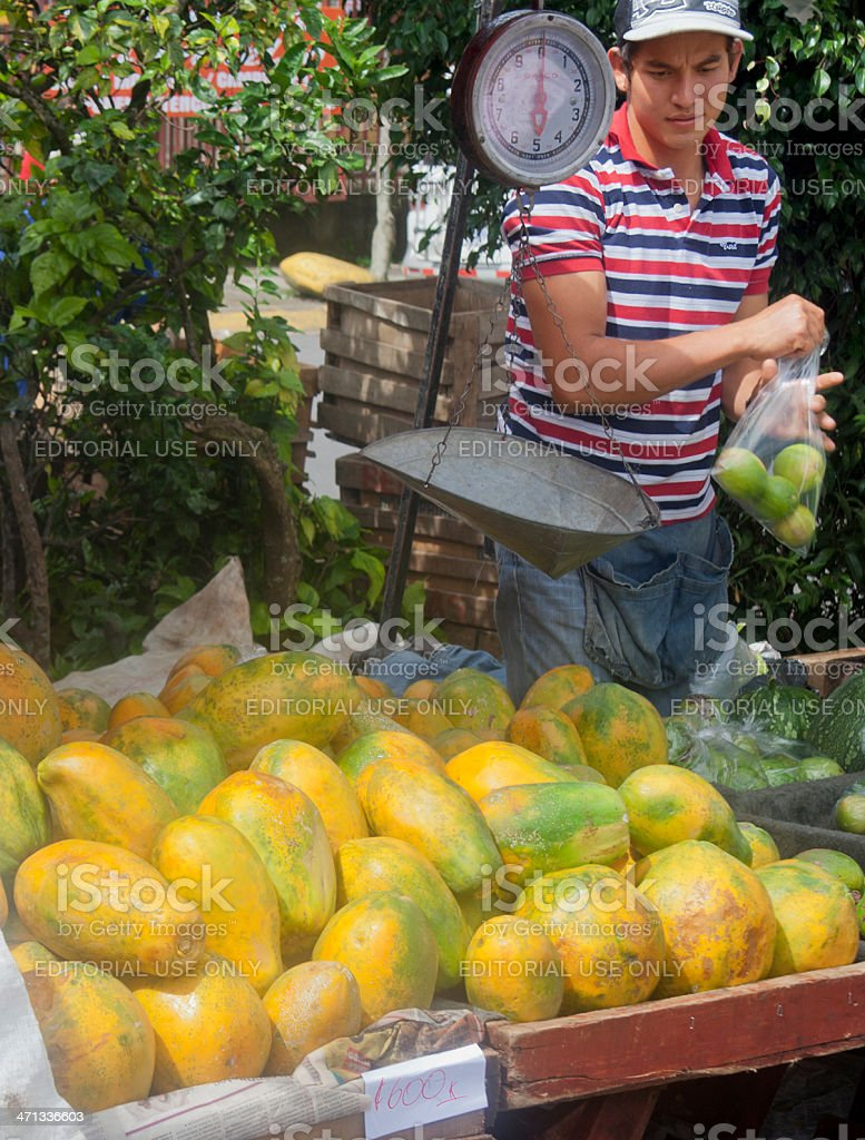 Market Vendor selling fruits in San Jose, Costa Rica royalty-free stock photo