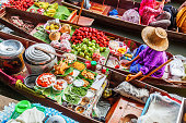 market woman at Damnoen Saduak in Thailand