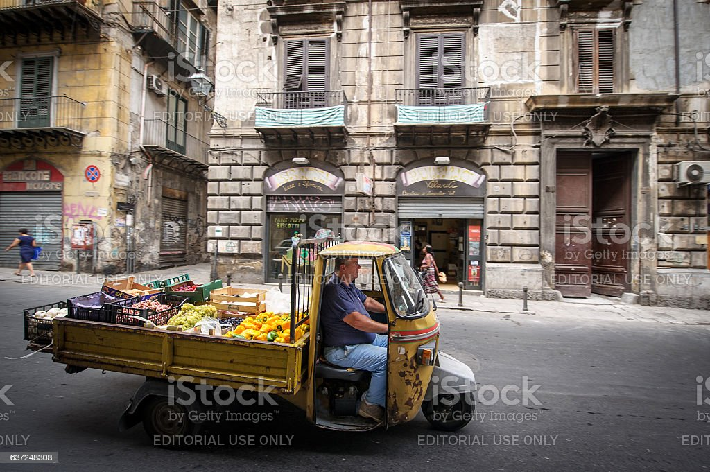 Marketer on apecar in Palermo stock photo