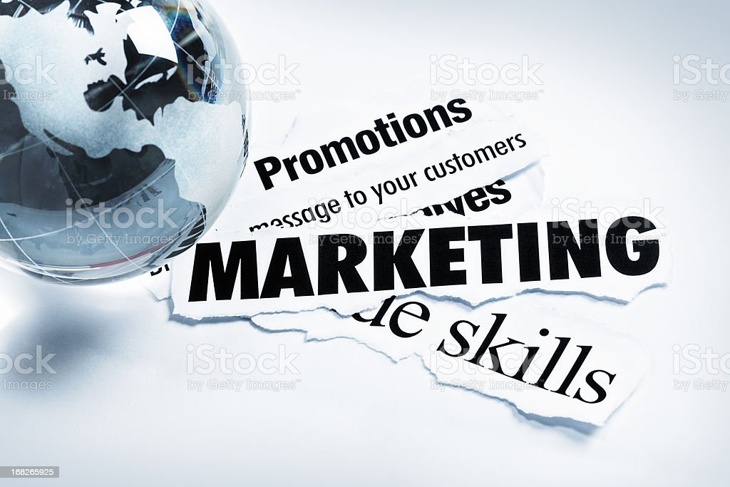 Marketing and promotions headlines with globe-shaped paperweight stock photo